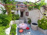 Leisure area in front of this villa in Sutivan on Brač island