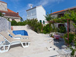 Pool area in front of villa in Sutivan on Brač island