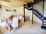 Dining room, living room and the stairs for upper floor in stone rental house in Dubrovnik