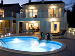 Modern villa with pool in Sumartin on Brac island Dalmatia Croatia by night