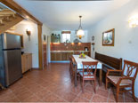 Dining room and kitchen in this old and renovated vacation villa for rent in Dubrovnik