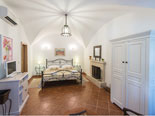 Master suite with fireplace and en-suite bathroom with shower on the ground floor in this Dubrovnik villa