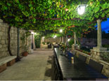 Courtyard dining and lounge area in this villa in Dubrovnik by night