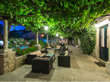 View from the east on courtyard dining and lounge area in this villa in Dubrovnik by night