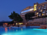 View on the five stars Hotel Dubrovnik Palace from the outdoor pool by night