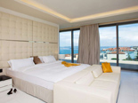 White Presidential suite bedroom at the five stars Kempinski Hotel Adriatic Istria Croatia