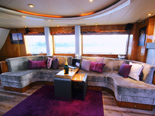 Lavish lounge on the Elegance 82, a luxury yacht for charter in Croatia.